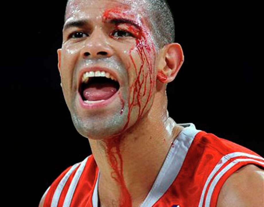 Houston Rockets' Shane Battier tries to call for time after getting hit in the face by the Los Angeles Lakers' Sasha Vujacic in the first quarter of Game 1 of an NBA second-round playoff basketball series in Los Angeles, AP Photo/Los Angeles Times, Wally Skalij / Los Angeles Times