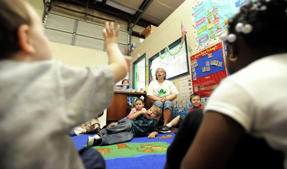 Teacher, Darla VanderWeg answers questions from students at Green Frog Day Care Pre-School in Nederland, Wednesday. Tammy McKinley, The Enterprise