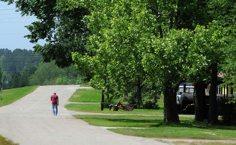 A man walks down Long Leaf Street in Pineland on Thursday, April 30, 2009. At 13 percent, Sabine County recently received the highest unemployment rate in East Texas. Guiseppe Barranco/The Enterprise