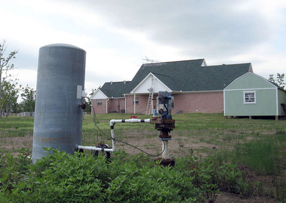 The water well behind Greg Orbea's home on Old Big Hill Road tastes too salty to drink. He is among hundreds of homeowners who will get potable water within the next six months. Kyle Peveto/ The Enterprise