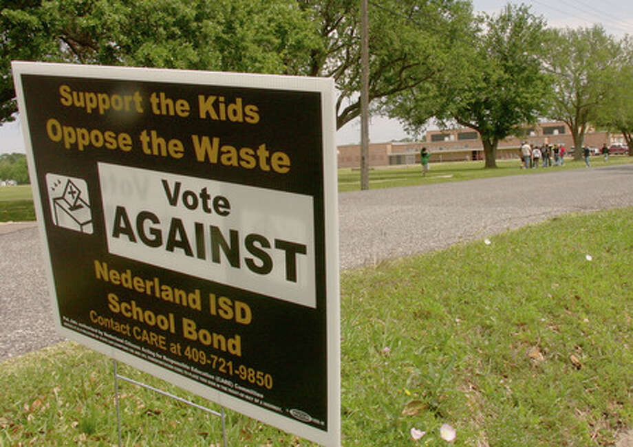 A sign in opposition to the upcoming bond election on May 9 is posted along 27th Street across from the C.O. Wilson Middle School campus. Greg Hayes/The Enterprise