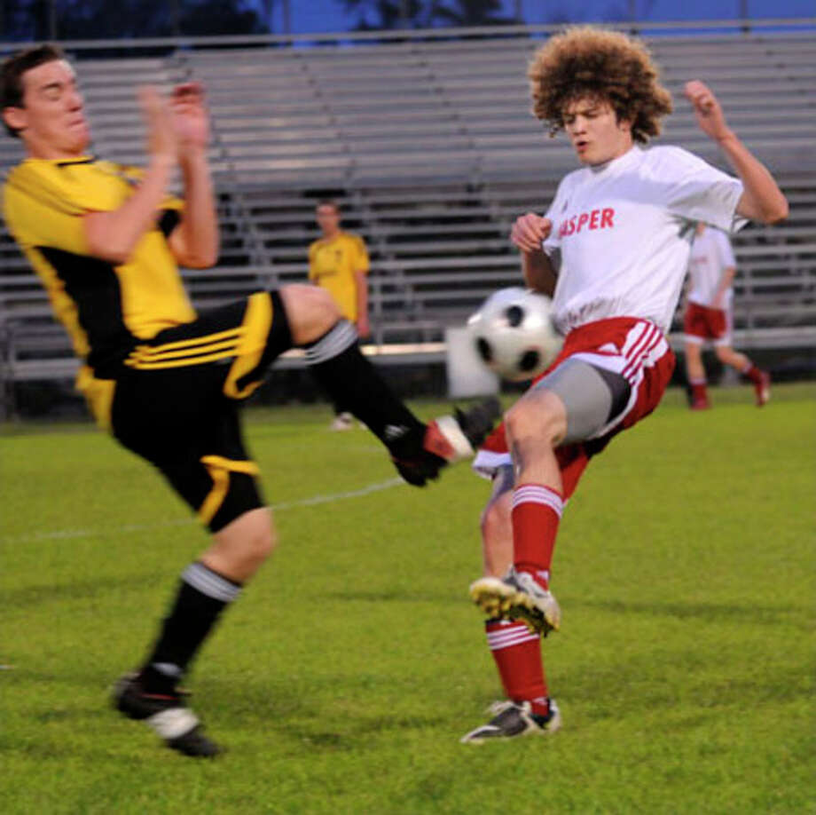 Jasper?s Parker Stover stops a Vidor offensive attack during a recent contest.