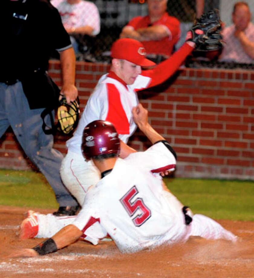 Jasper?s Tyler Ernest scampers home on a wild pitch for the Dawgs only score in a 2-1 loss to Carthage.