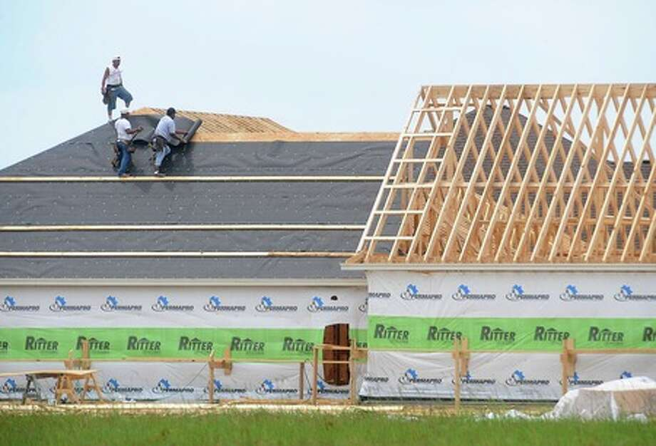 Laborers lay felt on the roof of a home being constructed near Major Drive and Folsom Drive on Wednesday. Guiseppe Barranco/The Enterprise