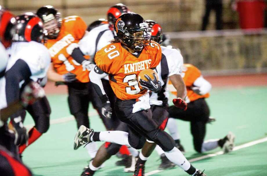 Stamford's Jakai Wilson carries as Stamford High School hosts Bridgeport Central in a football game Friday, October 29, 2010. Central won 33-16. Photo: Keelin Daly / Stamford Advocate