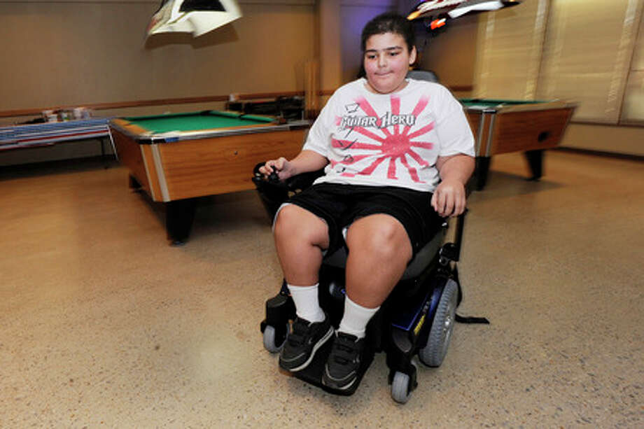 Thomas Goodwin, 13, of Saratoga, test drives his new power chair presented by the Beaumont Elks Lodge for special needs children.  Valentino Mauricio/The Enterprise