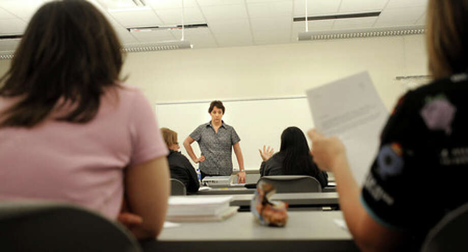 Instructor Lydia Bahnsen teaches students in the ACE program in Bridge City, Tuesday. Tammy McKinley, The Enterprise