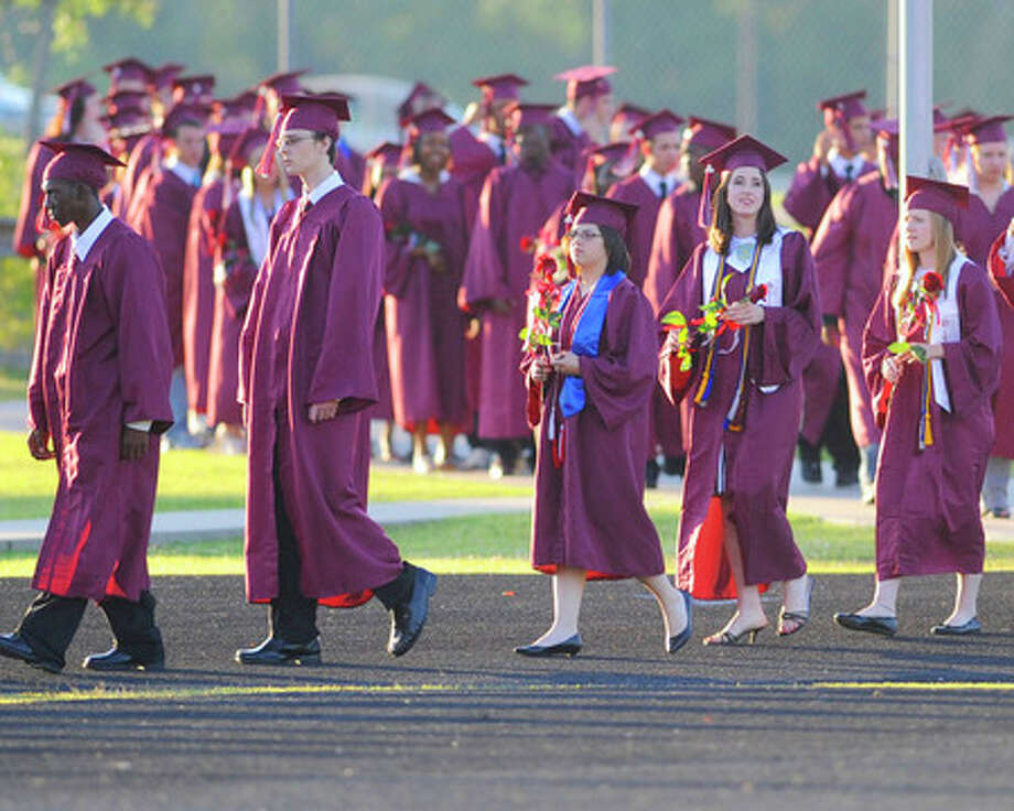 The Silsbee High School Class of 2009 enters Tiger Stadium for their graduation ceremony on Friday. Valentino Mauricio/The Enterprise
