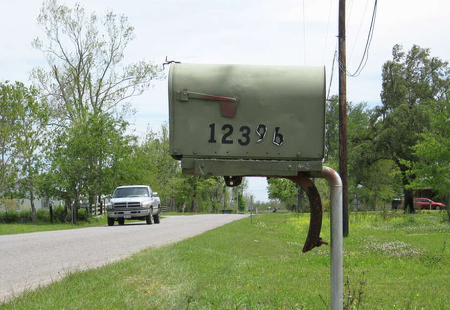 The house numbers listed on Donna Bryan's Hamshire-area mailbox are difficult for emergency vehicle drivers to read at night, according to proponents of a recently written state legislation. Kyle Peveto/The Enterprise