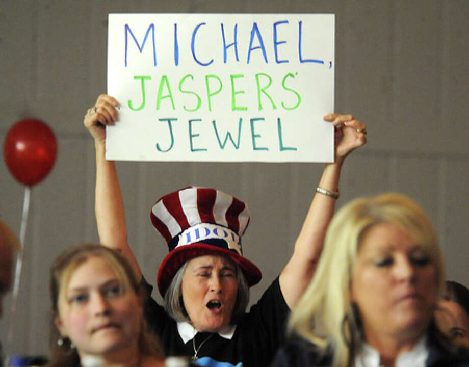Becki Mayhar roots for Michael Sarver despite the jugdes harsh words at the Harvet Churches American Idol watch party in Jasper, Wednesday. Tammy McKinley, The Enterprise