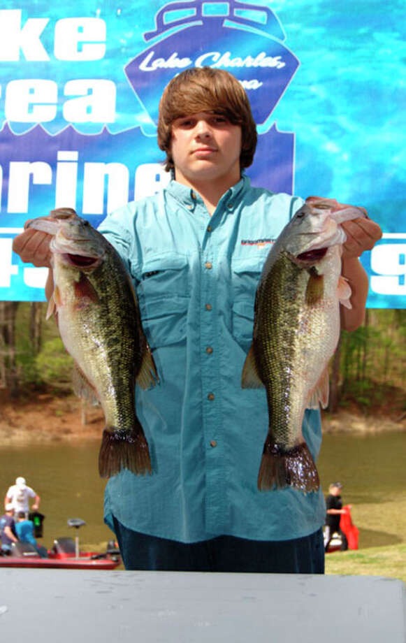 Jeffrey Cox Jr, a sophomore at Rosepine La. High School, holds up two fish of the limit he brought to the scales at the first High School Open Team Tournament.