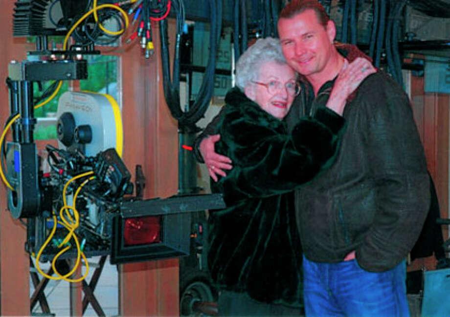 Inez Murray hugs her son-in-law Detlif Bittner while on the set.