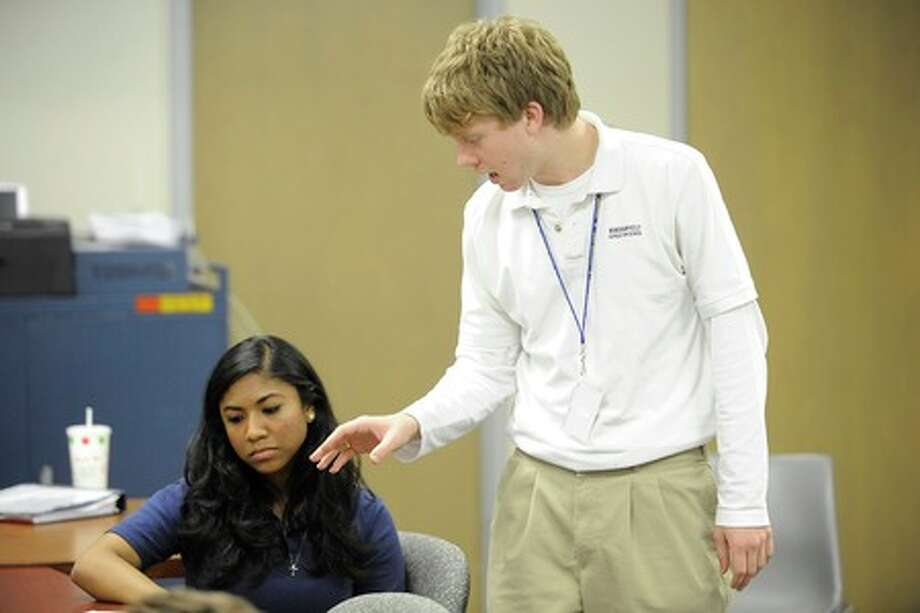Kelly senior, Evan Lee, right, practices cross-examining a hostile witness, Shalea Francois, as the lead attorney for the Kelly High School Mock Trial Team during a rehearsal session on Tuesday. Valentino Mauricio/The Enterprise