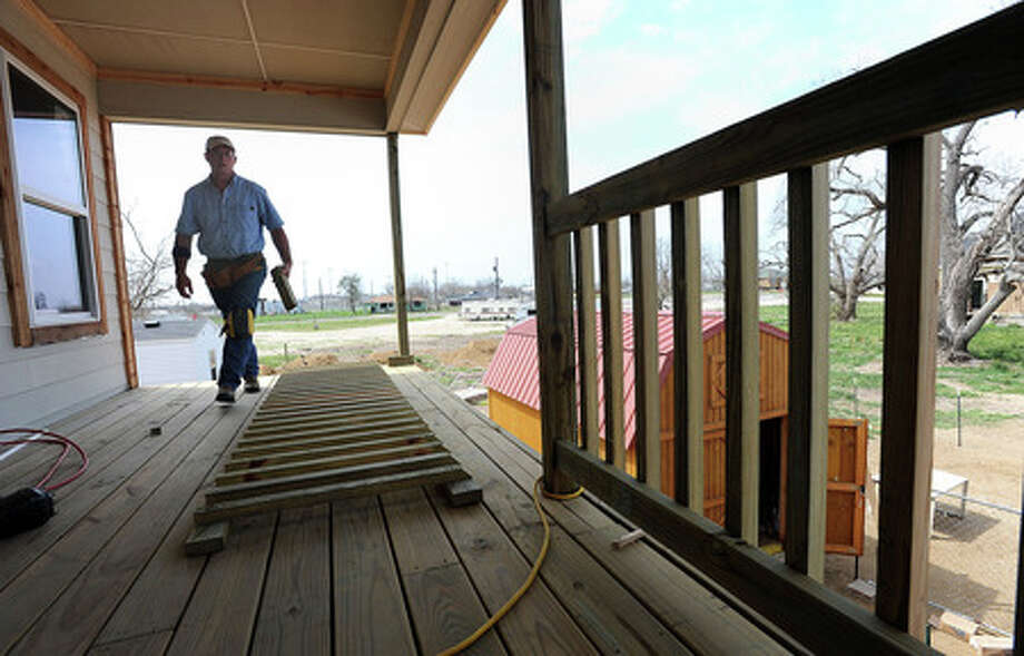 Larry Karrer builds the deck on his Uncle's Sabine Pass home on Wednesday, March 11, 2009. Most post Hurricane Ike homes in the area are required to be built more than 10 feet above the ground. Guiseppe Barranco/The Enterprise