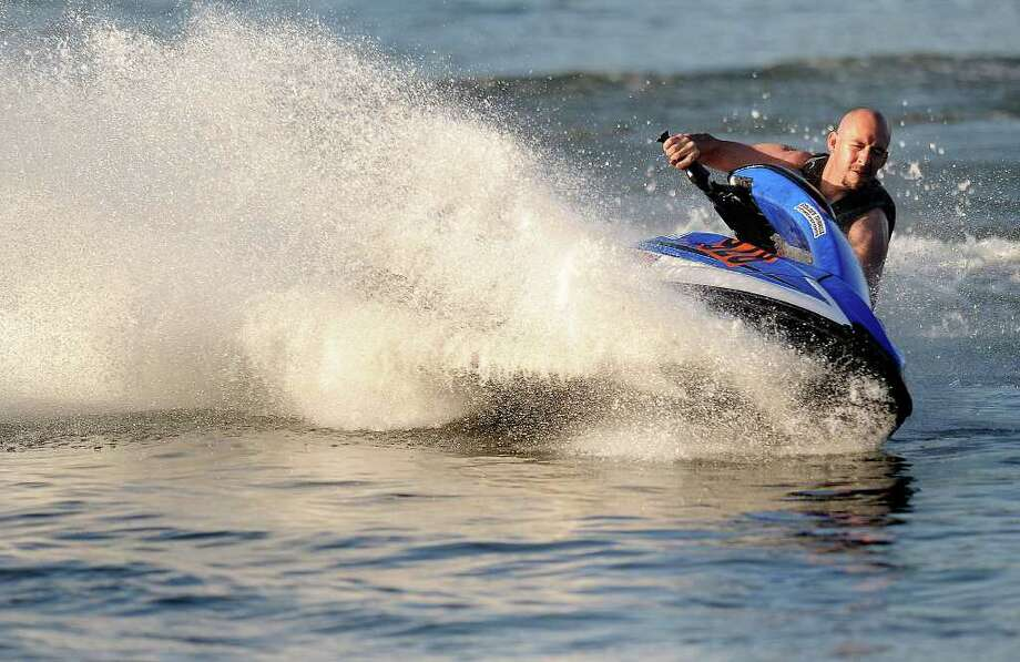 Devon Hathaway corners a ball during jet ski practice at Boomtown USA Resort on Sunday. Domingue and his team of jet skiers are gearing up for a competition. Guiseppe Barranco/The Enterprise