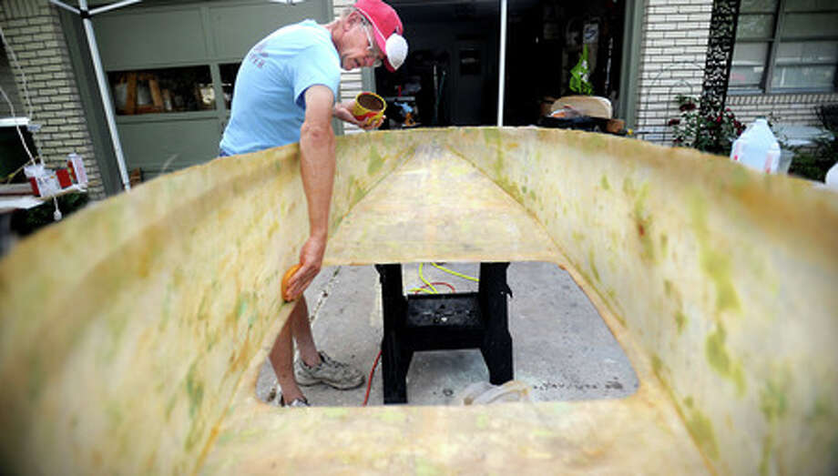 Mickey Rouse waxes a soap box mold at his home in Beaumont, Saturday. Tammy McKinley, The Enterprise