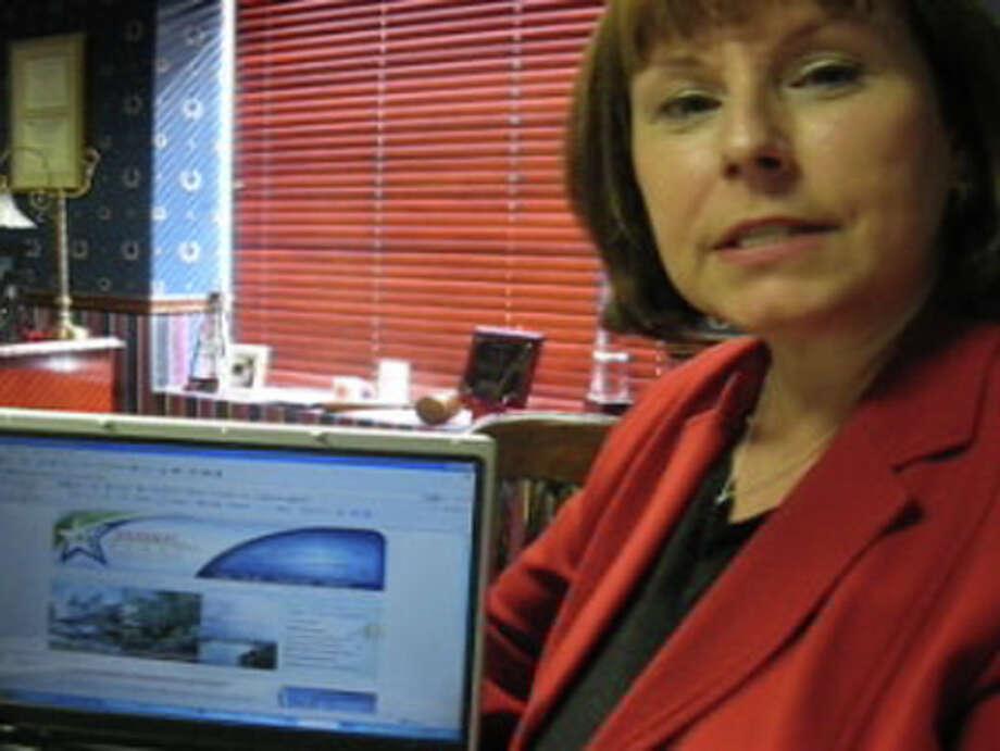 Ann Galassi, chairwoman of the Regional Economic Development Initiative, talks about new Web site. Dan Wallach/The Enterprise
