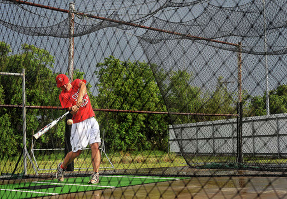Bridge City's Matt Hicks swings at the ball during practice on Memorial Day. The team is gearing up for the next round of playoffs. Guiseppe Barranco/The Enterprise