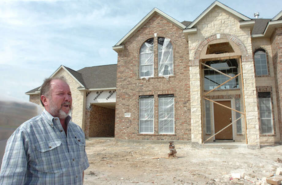 There are currently four new homes, including this Compass Pointe Homes model home, under construction at Mike Doguet's Diamond D Rancg developemnt on U.S. 90 three and half miles west of the Beaumont city limits. Pete Churton/The Enterprise
