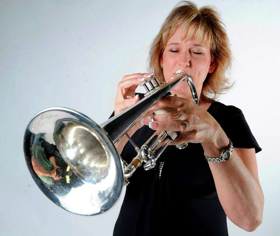 Gail Labath plays trumpet with the Night and Day Orchestra. The orchestra will perform Saturday at 3 p.m. at the South Texas State Fair. Valentino Mauricio/The Enterprise