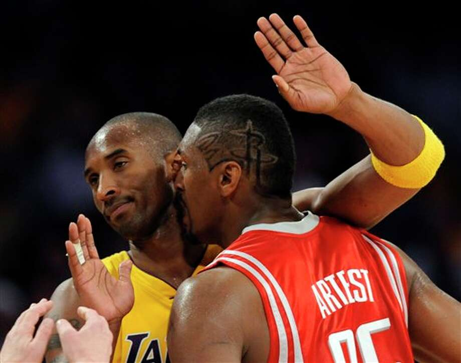 Los Angeles Lakers guard Kobe Bryant, left, and Houston Rockets forward Ron Artest exchange words in the second half during Game 2 of a second-round NBA playoff series in Los Angeles, Wednesday, May 6, 2009. The Lakers won 111-98. (AP Photo/Chris Carlson)
