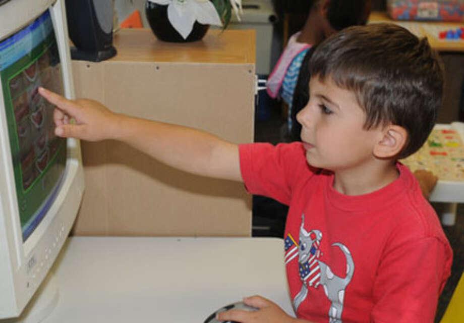 Richard Sunday works on language arts skills on the classroom computer.