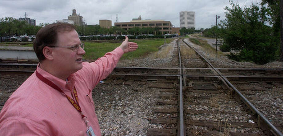 The Port of Beaumont's big railroad projects could start as early as this summer. Chris Fisher, Executive Director of the port talks about how the new Main Street turnout train track will enter the port and the holding area behind city hall will be gone.  Dave Ryan/The Enterprise