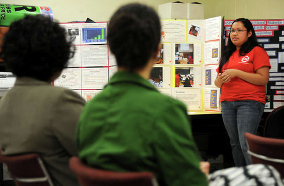 Iris Garcia presents her poster that she uses for recruiting outreach during the Inspired Showcase presentation at Lamar University in Beaumont, Wednesday. Tammy McKinley, The Enterprise