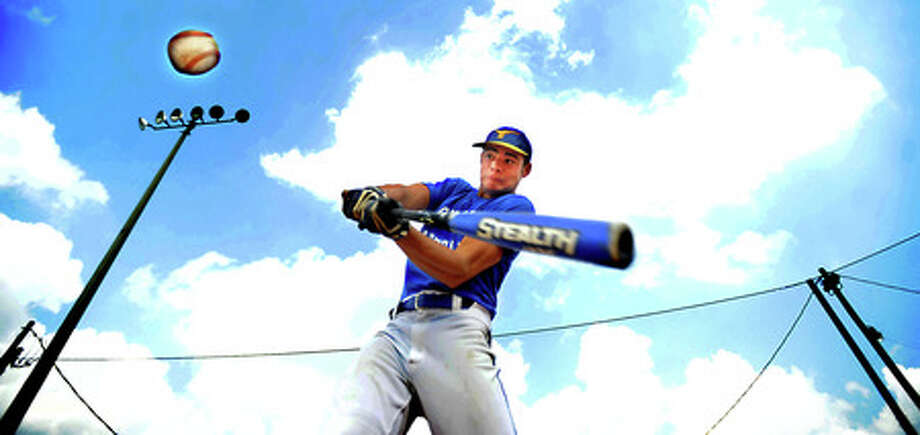 Jeremy Pinder practices batting at Hamshire-Fannett High School in Hamshire, Tuesday. Tammy McKinley, The Enterprise