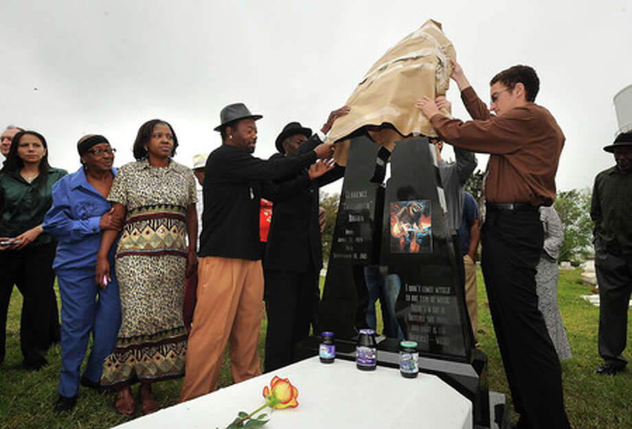 Friends and family gather Tuesday at Hollywood Cemetery during the unveiling of a new grave marker for Clarence 'Gatemouth' Brown. Guiseppe Barranco/The Enterprise