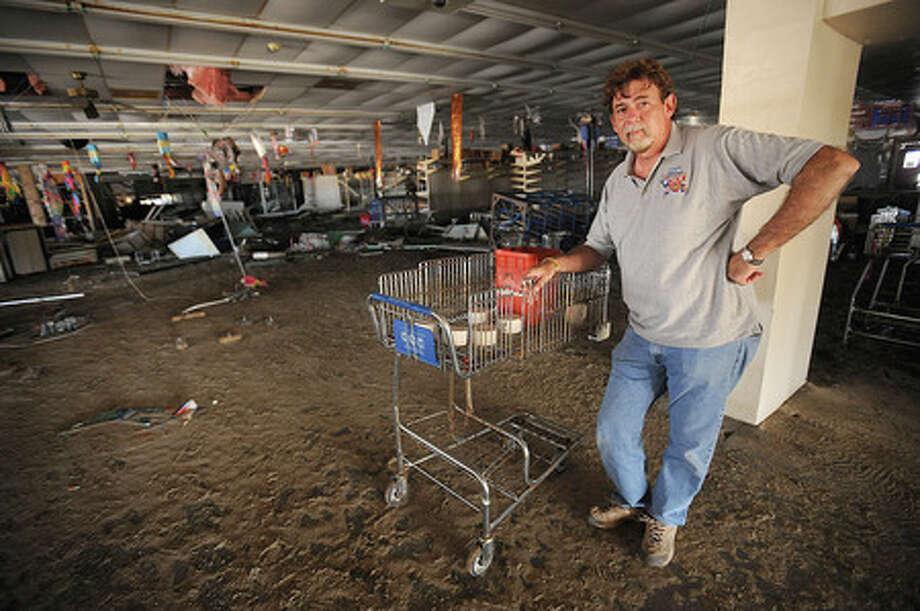 Keith Zarhar  inside the Hurricane Ike-ravaged Gulf Coast Super Market on Bolivar Peninsula on Wednesday, October 15, 2008. Enterprise file photo
