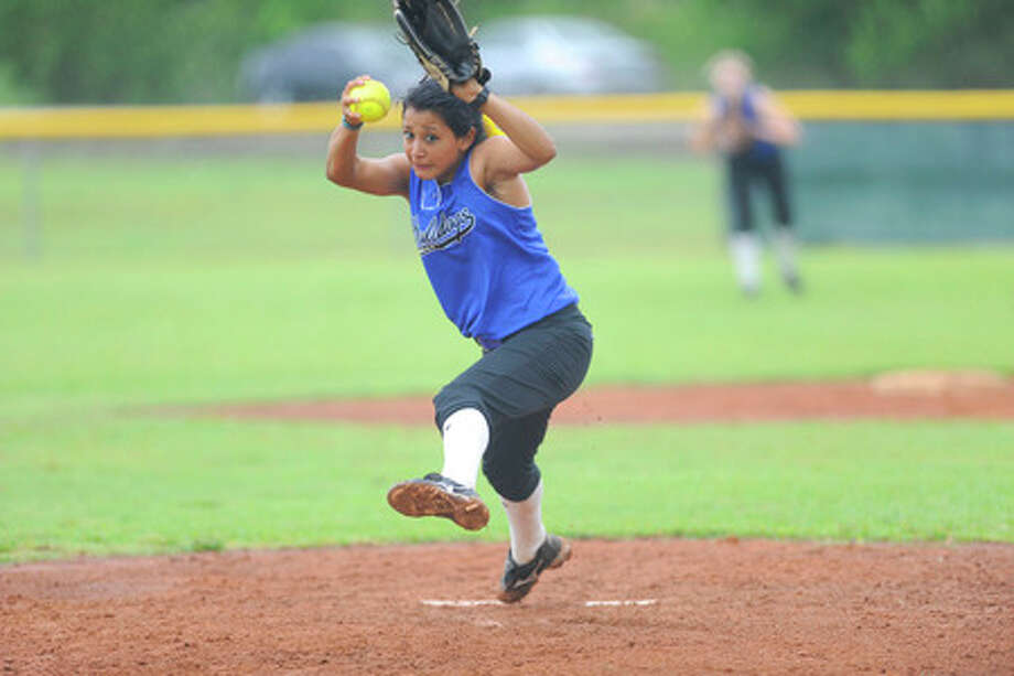Kelly starter Brittany Godina winds up for the fast pitch against St. Agnes Academy on Thursday. Valentino Mauricio/The Enterprise