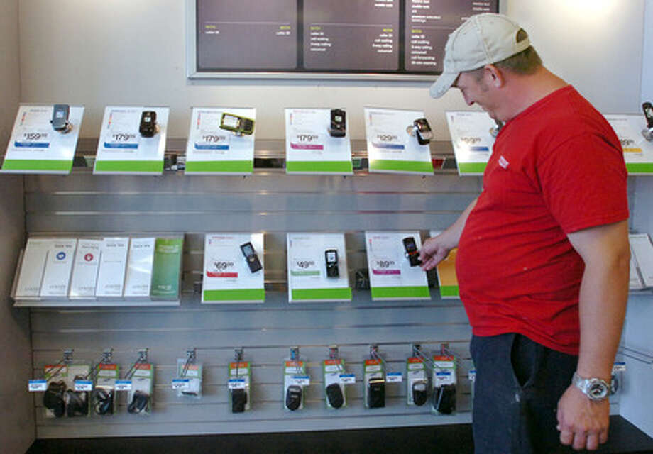 David McDonald of Beaumont checks out the flat rate cell phones at Cricket Wireless on Dowlen Road in Beaumont Monday afternoon. Pete Churton/The Enterprise