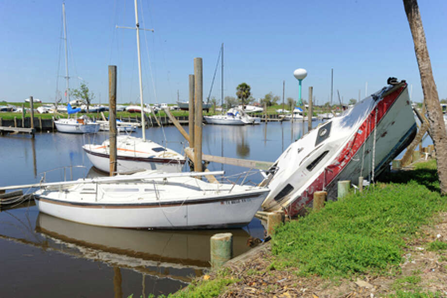 At Pleasure Island yacht club, damaged boats and docks dot the area from the after effects of Hurricane Ike.  Friday, April 3 2009.  Valentino Mauricio/The Enterprise