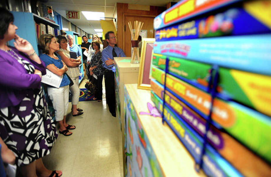 Parents, guests and Nederland voters experience the narrow cooridors of Langum Elementary classrooms during an open house Monday night. Guiseppe Barranco/The Enterprise