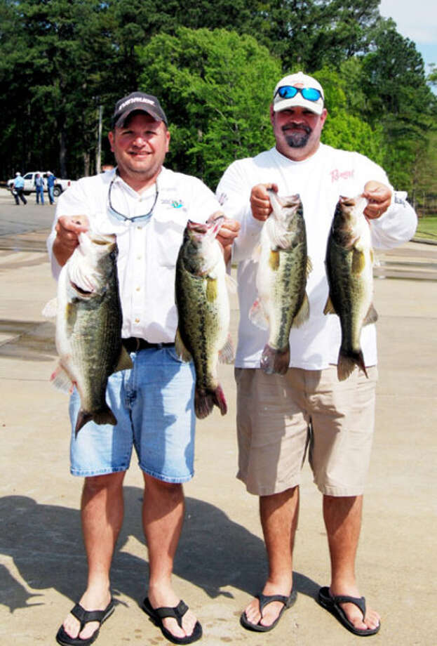 Todd Naquin and Scott McFarlain show part of the 26.04 pound day 2 catch, biggest catch of the 15th Annual Louisiana Oilmen's Bass Invitational tournament held April 3-4 on Toledo Bend Reservoir. It earned them the first place trophy, championship rings and a check for $3,000.