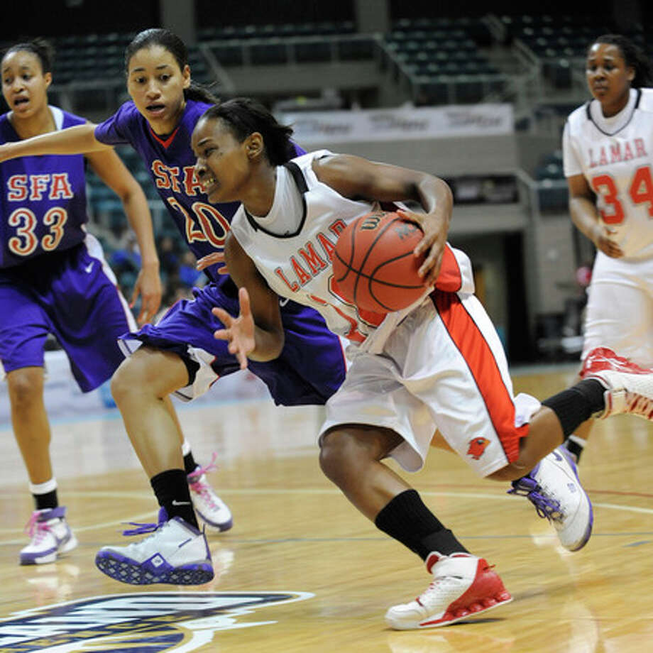 Lamar guard, Nikki Williams,  drives around Ladyjacks defender, Whitney Cormier (20),  during first half action at the  Southland Conference Basketball Tournament at the Leonard E. Merrell Center in Katy on Wednesday. Valentino Mauricio/The Enterprise