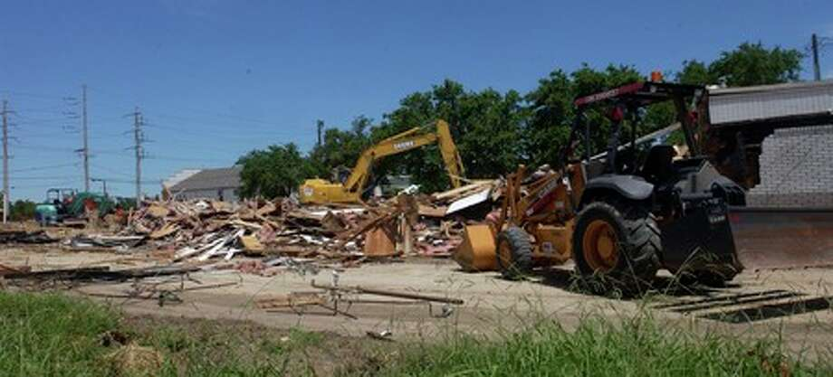 The former Burger King restaurant at the IH-10 service road and Gulf Street is being demolished to make way for a new fast food establishment.   Dave Ryan/The Enterprise