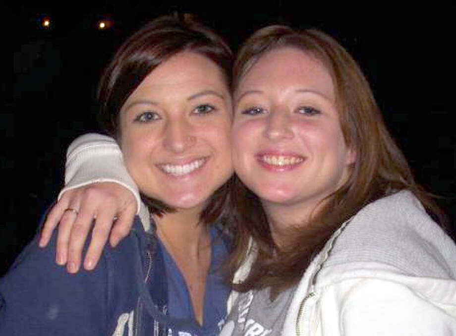 Ashley Schkade, 26, right, shown with her sister, Lori Schkade, 23, was killed early Thursday morning when her car struck a stopped train on Calder Avenue in Beaumont.