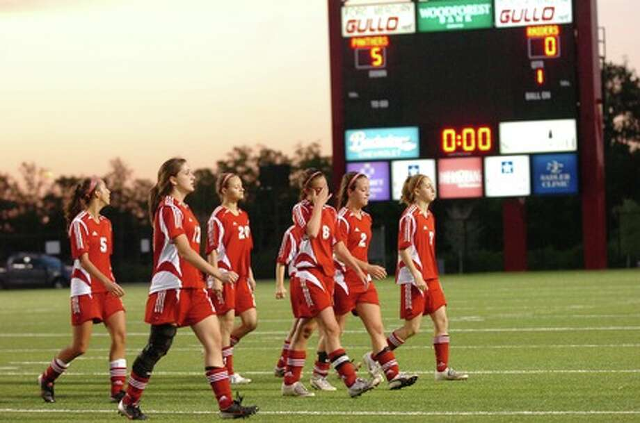 The Lumberton Girls soccer team leaves the field after falling to Waco Midway, 5-0, in  the regional semifinal round at Woodforest Stadium in Shenandoah on Tuesday.  March 31, 2009.  Valentino Mauricio/The Enterprise