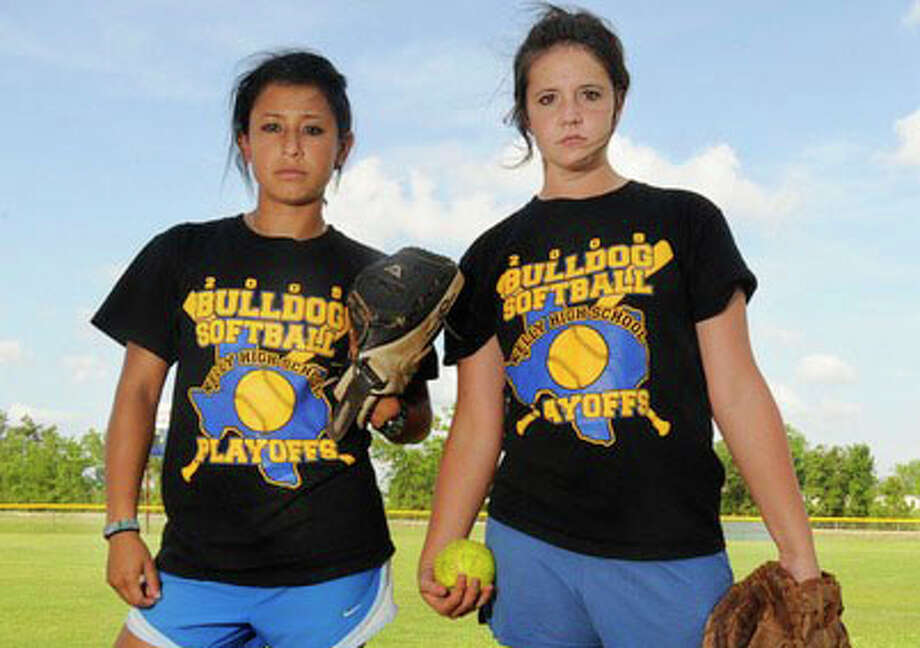 Most high school softball teams rely on one pitcher to succeed, Kelly High School relies on the duo of Brittany Godina, left,  and Emalee Kennon. Valentino Mauricio/The Enterprise