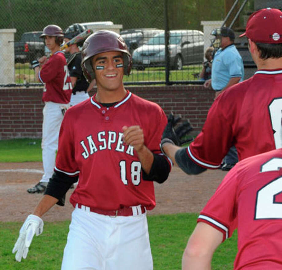 Jasper?s Marx Marcantel is greeted by his teammates as he scores a  run. Marcantel also doubled in two runs.