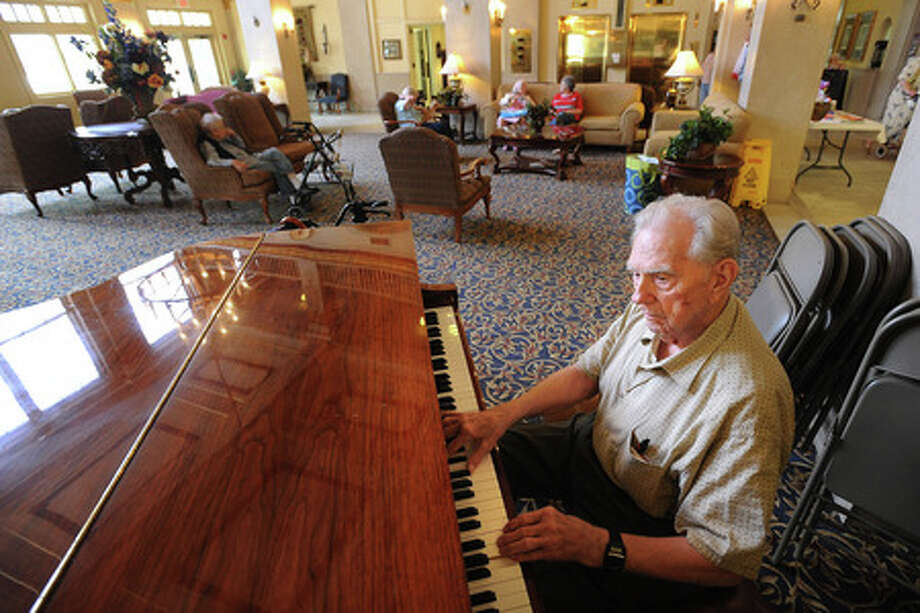 Jack Cook tickles the ivories for guests, residents and workers at Hotel Beaumont on Thursday. Guiseppe Barranco/The Enterprise