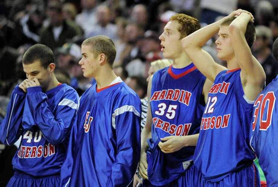 Hardin-Jefferson players react as the team falls, 77-73 in an overtime loss against Lubbock Estacado Matadors in the Class 3A boys basketball state semifinal at the Frank Erwin Center in Austin. Thursday,  March 12,  2009.  Valentino Mauricio/The Enterprise
