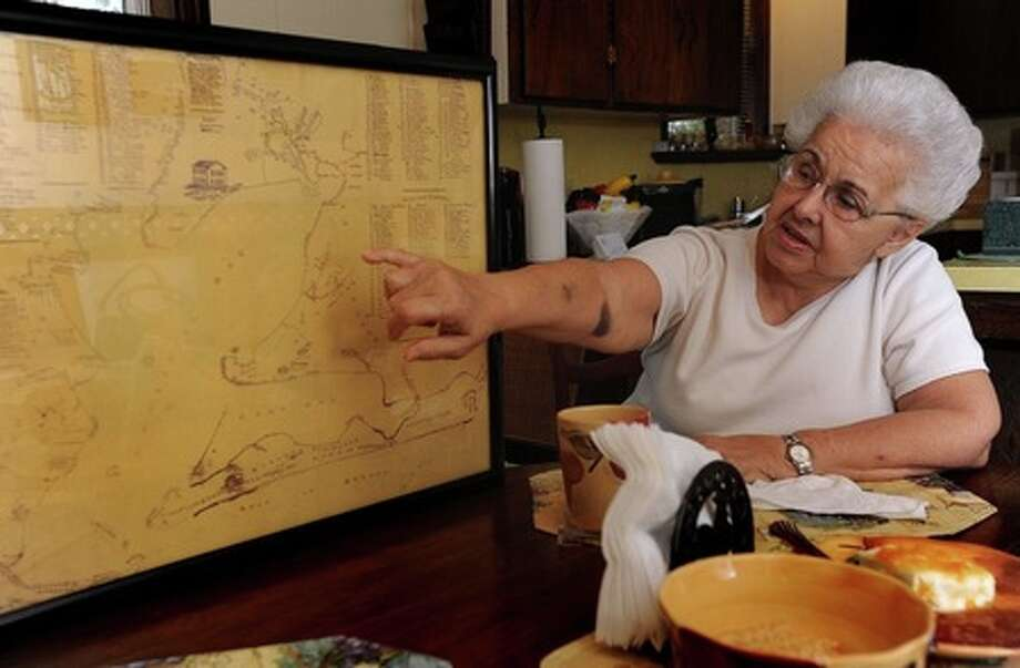 Ruth Stanford points to one of two Masonic Lodges drawn onto an 1885 map of Galveston Bay and its surrounding areas. Stanford said she received the map from the Johnson of Bolivar Peninsula in 1990. Guiseppe Barranco/The Enterprise