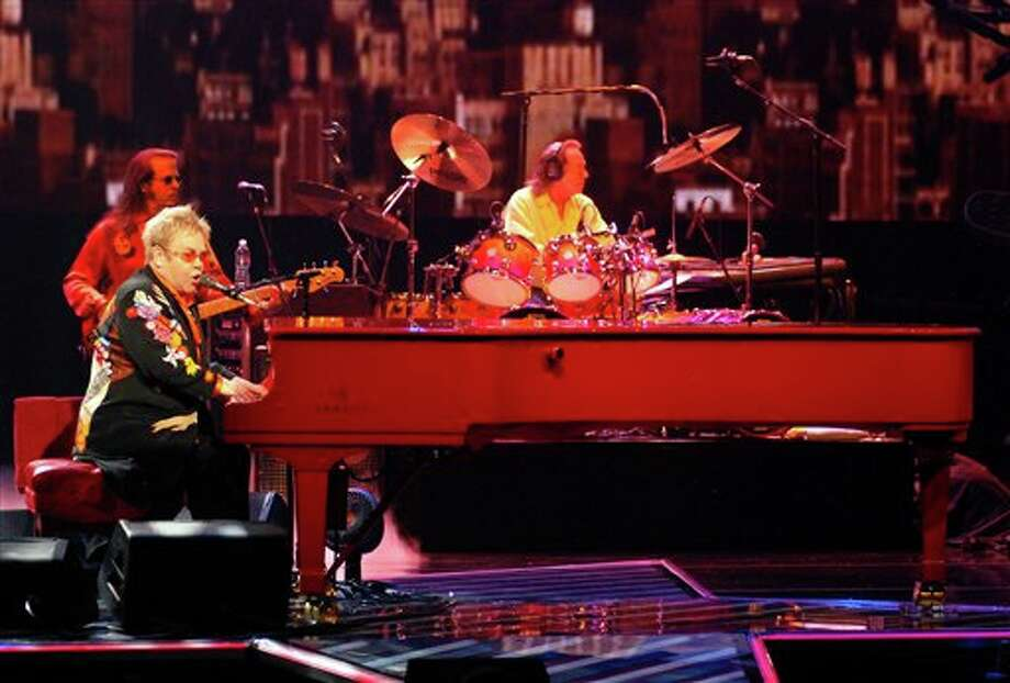"In this photo provided by the Las Vegas News Bureau, Elton John performs his 200th concert of ""The Red Piano"" at the Colosseum at Caesars Palace in Las Vegas Saturday June 21, 2008.  (AP Photo/Las Vegas News Bureau, Steve Spatafore)  **NO SALES**"