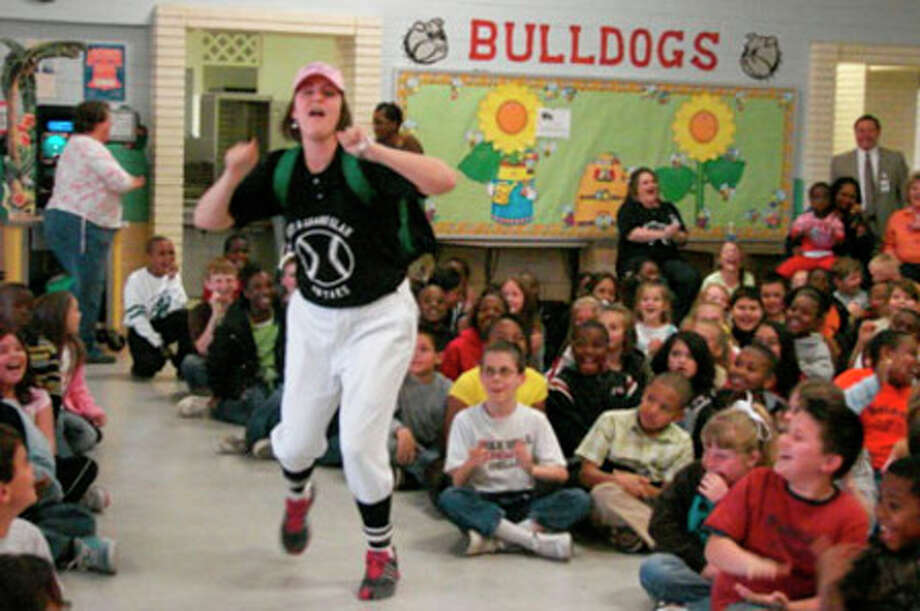 On Monday, March 2, Parnell held a TAKS Pep Rally to get the third and fourth graders built up to take their TAKS reading and TAKS writing tests on March 3. Our theme was ?Hit a Grand Slam on the TAKS!?.? Fourth grade reading teacher Melissa O?Neal was ready to bring on home for Parnell.