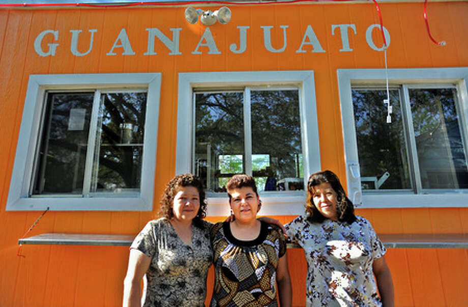 Co-owners Martha Parra, Maria Zarate, and Estela Cordenas pose in front of their food cart at their home in Beaumont, Tuesday. Mobile food vendors are having a more difficult time re-opening after the city of Beaumont enacted stricter guidlines. Tammy McKinley, The Enterprise