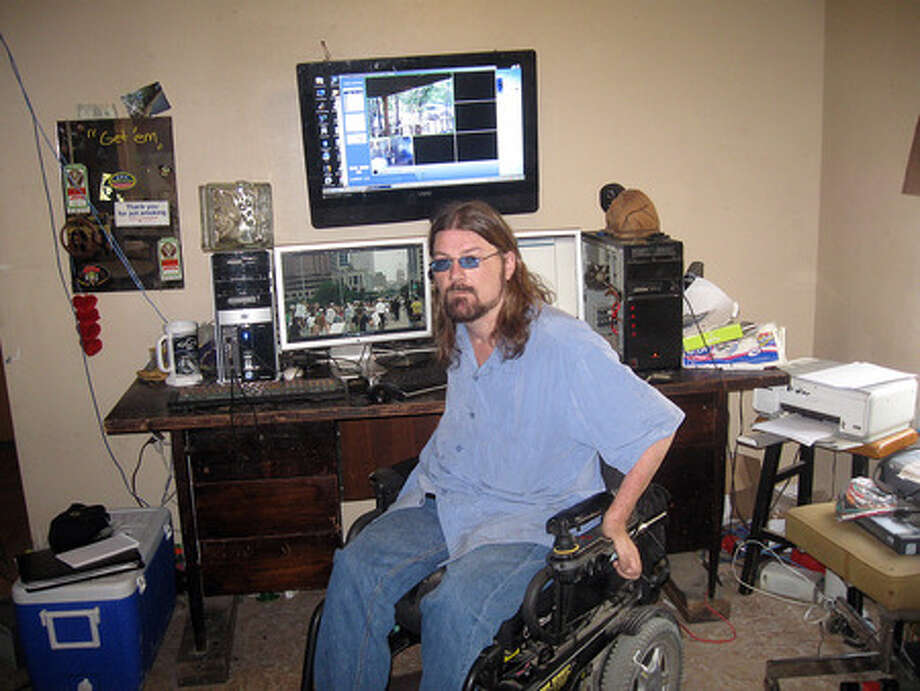 Chris Cain, 39, a Kountze Web site consultant, says marijuana helps ease muscle spasms he has suffered since being paralyzed in a diving accident and has advocated legalizing the drug for medicinal purposes since 2004. Colin Guy/The Enterprise