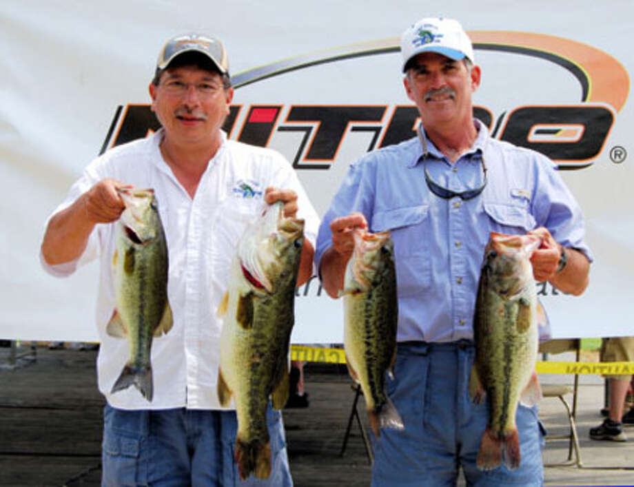 Bob Laroux (left) and George Herr show part of their day 2 catch that earned them the win at the 2nd Annual Toledo Bend Oilman's Classic team tournament held April 24-25. Their day 2 catch, weighing 20.27 pounds, was second best of the day and gave them a margin of victory of 0.09 pounds.
